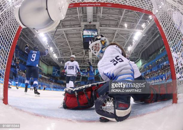 S goalie Madeline Rooney grabs the puck after Finland's Venla Hovi scored in the women's preliminary round ice hockey match between Finland and the...