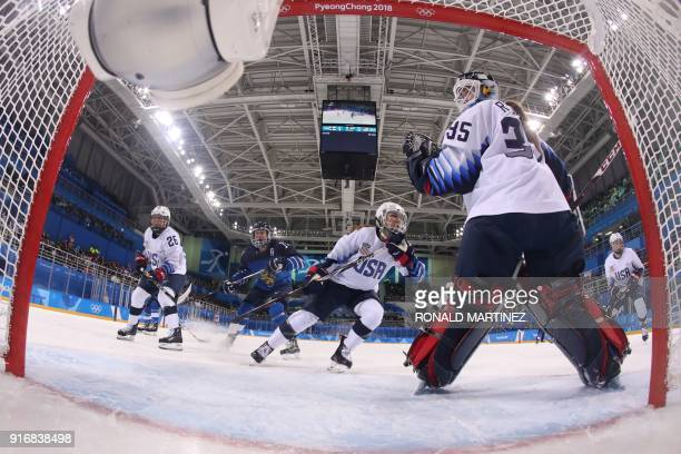 S goalie Madeline Rooney looks on as the puck goes behind the net in the women's preliminary round ice hockey match between Finland and the US during...