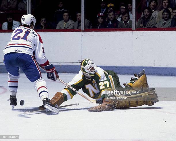 MONTREAL 1980's Goaltender Gilles Meloche of the Minnesota North Stars protects the net against Guy Carbonneau of the Montreal Canadiens in the...