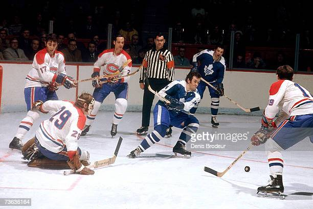 Goaltender Ken Dryden, Murray Wilson, Larry Robinson and Jacques Laperriere of the Montreal Canadiens defend against Dave Keon of the Toronto Maple...