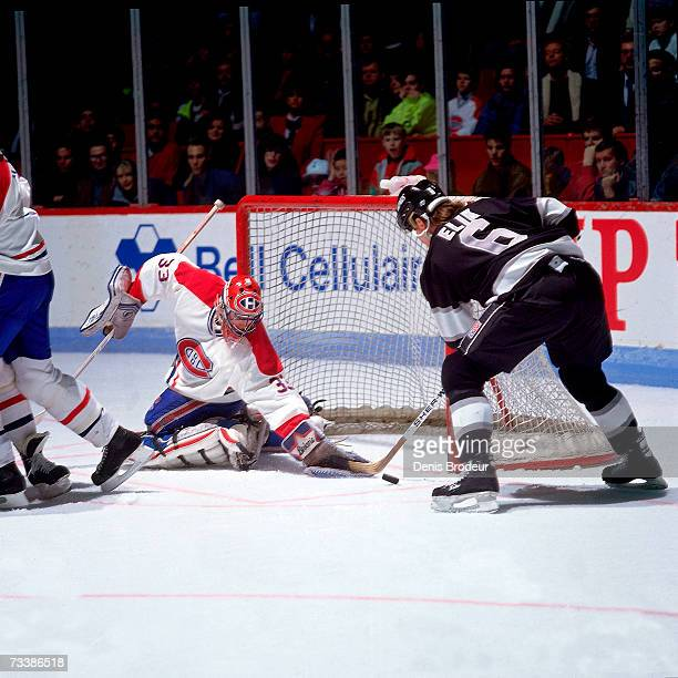 MONTREAL 1990's Goaltender Patrick Roy of the Montreal Canadiens attempts to stop the puck against Todd Elik of the Los Angeles Kings during the game