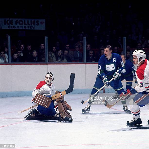 Goaltender Rogatien Vachon and Jean-Claude Tremblay of the Montreal Canadiens defend against the Vancouver Canucks.