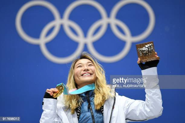 TOPSHOT USA's gold medallist Chloe Kim poses on the podium during the medal ceremony for the snowboard women's Halfpipe at the Pyeongchang Medals...