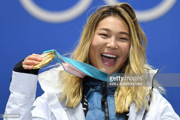 S gold medallist Chloe Kim poses on the podium during the medal ceremony for the snowboard women's Halfpipe at the Pyeongchang Medals Plaza during...