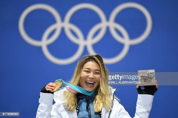 USA's gold medallist Chloe Kim poses on the podium during the medal ceremony for the snowboard women's Halfpipe at the Pyeongchang Medals Plaza...