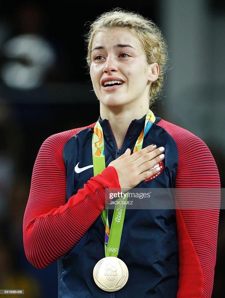 USA's gold medallist Helen Louise Maroulis celebrates on the podium at the end of the women's 53kg freestyle wrestling event at the Carioca Arena 2 in Rio de Janeiro on August 18, 2016, during the Rio 2016 Olympic Games. / AFP / Jack GUEZ