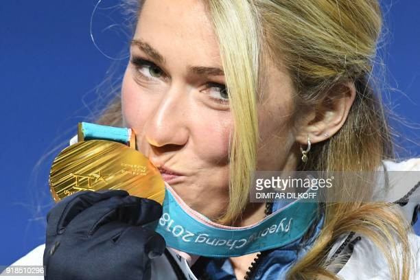 TOPSHOT USA's gold medallist Mikaela Shiffrin kisses her medal on the podium during the medal ceremony for the women's alpine skiing giant slalom at...