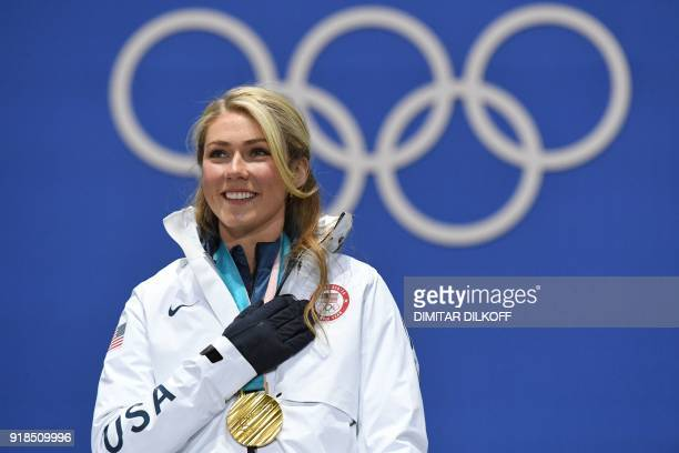 USA's gold medallist Mikaela Shiffrin poses on the podium during the medal ceremony for the women's alpine skiing giant slalom at the Pyeongchang...