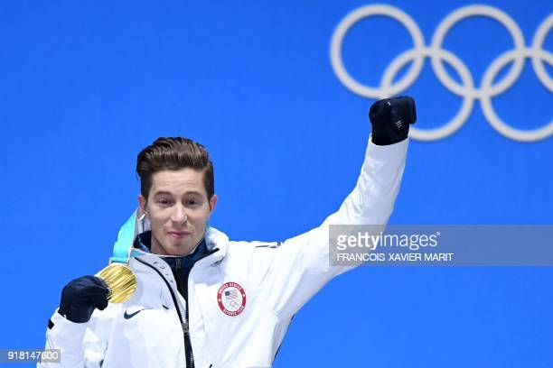 USA's gold medallist Shaun White poses on the podium during the medal ceremony for the men's snowboard halfpipe at the Pyeongchang Medals Plaza...