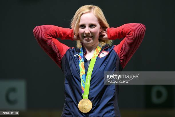 TOPSHOT USA's gold medallist Virginia Thrasher poses on the podium during the medal ceremony for the women's 10m air rifle shooting event at the Rio...