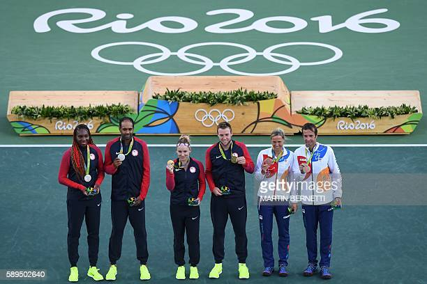 USA's gold medallists Bethanie MattekSands and Jack Sock pose near the podium with USA's silver medal winners Venus Williams and Rajeev Ram and Czech...