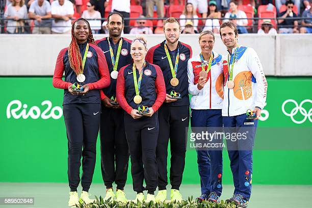 USA's gold medallists Bethanie MattekSands and Jack Sock pose on the podium with USA's silver medal winners Venus Williams and Rajeev Ram and Czech...