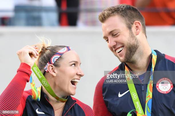 TOPSHOT USA's gold medallists Bethanie MattekSands and Jack Sock pose on the podium during the medal ceremony for the mixed doubles tennis event at...