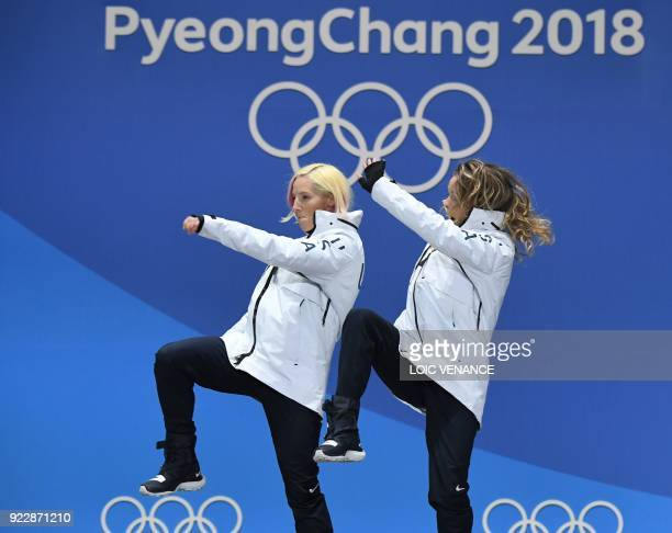 USA's gold medallists Kikkan Randall and Jessica Diggins dance on the podium during the medal ceremony for the cross country women's free team sprint...