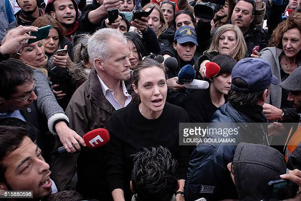 UNHCR's Goodwill Ambassador Angelina Jolie is surrounded by media and migrants in the port of Piraeus during a visit on March 16 2016 Some 4000...