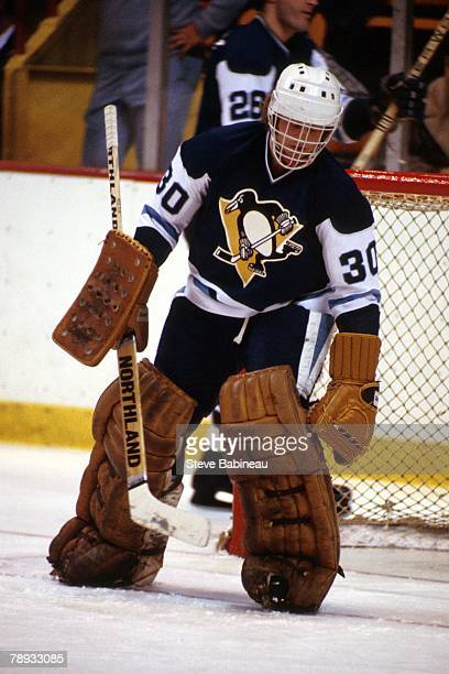 BOSTON MA 1970's Gord Laxton of the Pittsburgh Penguins in goal against the Boston Bruins