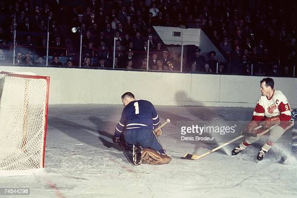 S: Gordie Howe of the Detroit Red Wings scores a goal against Johnny Bower of the Toronto Maple Leafs during their NHL game in Toronto, Canada.