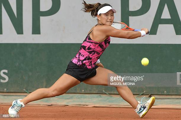 USA's Grace Min hits a return to Spain's Garbine Muguruza during their French tennis Open first round match at the Roland Garros stadium in Paris on...