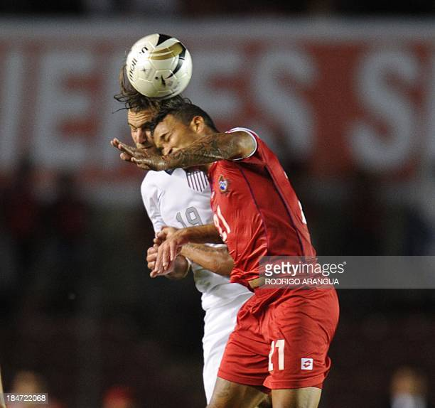 USA's Graham Zusi vies for the ball with Amilcar Henriquez of Panama during their Brazil 2014 FIFA World Cup Concacaf qualifier match on October 15...