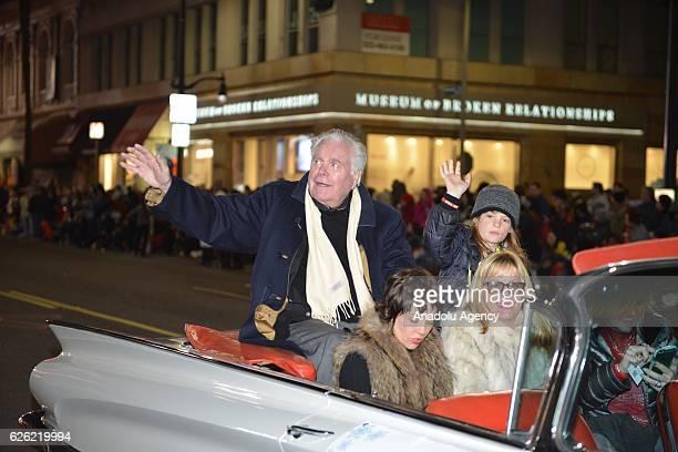 1976's Grand Marshal and Actor Robert Wagner waves to the crowd during the 85th Hollywood Christmas Parade in Hollywood CA United States on November...