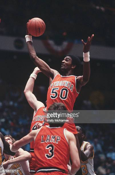 UVA's great center Ralph Sampson towers over the over players in his team's semifinal game against LSU won by LSU