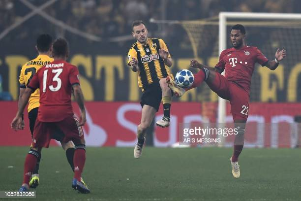AEK's Greek defender Michalis Bakakis vies with Bayern Munich's German forward Serge Gnabry during the UEFA Champions League football match between...