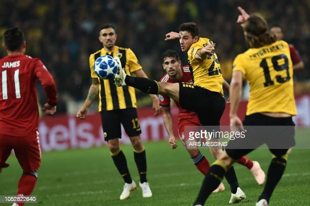 AEK's Greek midfielder Kostas Galanopoulos controls the ball during the UEFA Champions League football match between AEK Athens FC and FC Bayern...