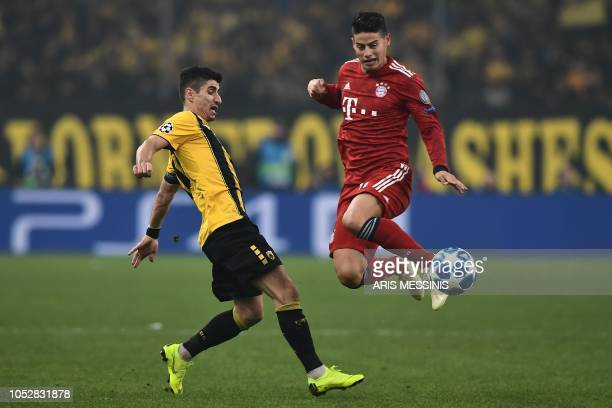 AEK's Greek midfielder Petros Mantalos vies with Bayern Munich's Colombian midfielder James Rodriguez during the UEFA Champions League football match...