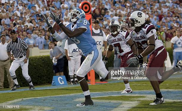 UNC's Greg Little loses control of a pass from quarterback TJ Yates in the end zone on a fourth down play late in the fourth quarter of play Saturday...