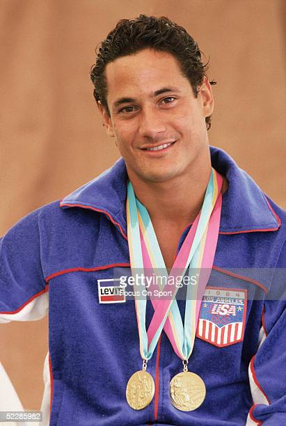 USA's Greg Louganis poses with his two gold medals during the Summer Olympics XXIII in 1984 in Los Angeles California
