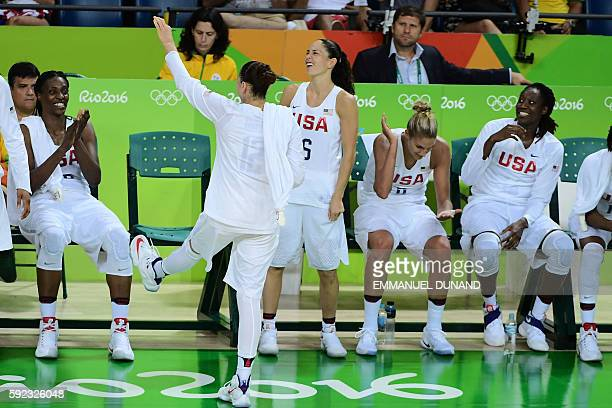 USA's guard Diana Taurasi jokes with USA's centre Sylvia Fowles during a Women's Gold medal basketball match between USA and Spain at the Carioca...