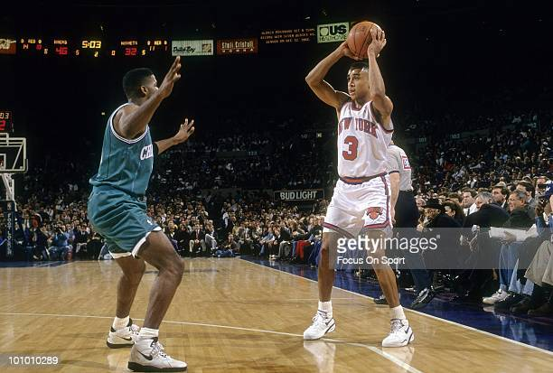 MANHATTAN NY CIRCA 1990's Guard John Starks of the New York Knicks in action is guarded by Kendall Gil of the Charlette Hornets circa early 1990's...
