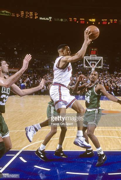 MANHATTAN NY CIRCA 1990's Guard John Starks of the New York Knicks in air surounded by Kevin McHale and Kevin Gamble of the Boston Celtics circa...