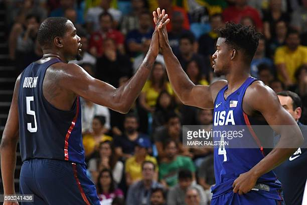 USA's guard Kevin Durant and USA's forward Jimmy Butler celebrate during a Men's Gold medal basketball match between Serbia and USA at the Carioca...