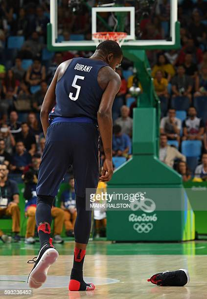 S guard Kevin Durant loses his shoe during a Men's Gold medal basketball match between Serbia and USA at the Carioca Arena 1 in Rio de Janeiro on...