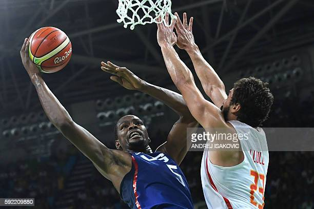 TOPSHOT USA's guard Kevin Durant scores past Spain's guard Sergio Llull during a Men's semifinal basketball match between Spain and USA at the...