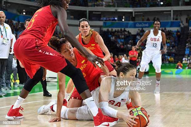 USA's guard Lindsay Whalen attempts to pass the ball under pressure from Spain's power forward Astou Ndour and Spain's point guard Laia Palau during...