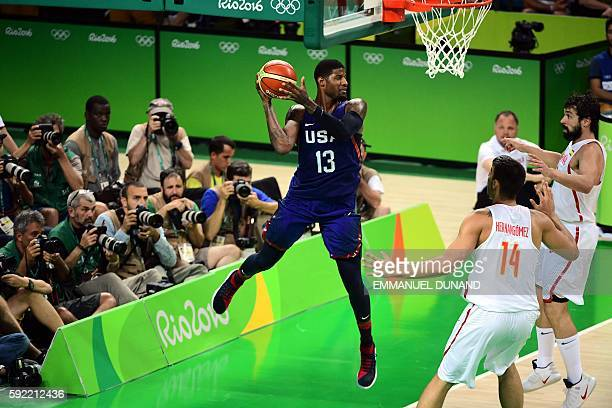USA's guard Paul George passes the ball as Spain's power forward Nikola Mirotic and Spain's guard Sergio Llull look on during a Men's semifinal...