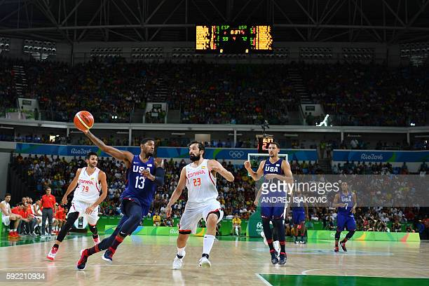 USA's guard Paul George vies with Spain's guard Sergio Llull during a Men's semifinal basketball match between Spain and USA at the Carioca Arena 1...