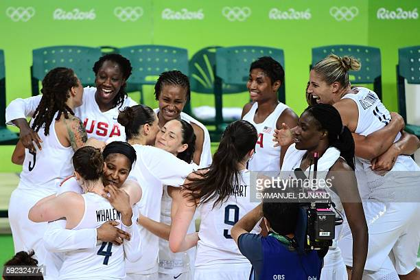 USA's guard Sue Bird celebrates with teammates after winning Women's Gold medal basketball match between USA and Spain at the Carioca Arena 1 in Rio...