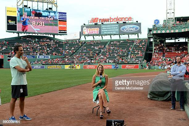 NESN's Guerin Austin reports prior to the game between the Boston Red Sox and the Arizona Diamondbacks at Fenway Park on August 12 2016 in Boston...