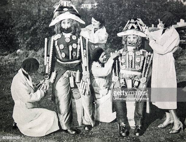 1920's Guy Fawkes Night preparing a guy made up from fireworks also known as Guy Fawkes Day Bonfire Night and Firework Night is an annual...