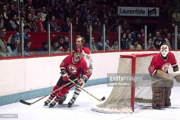 MONTREAL QC 1980's Guy Lafleur of the Montreal Canadiens skates behind Dennis Maruk of the Cleveland Barons during their NHL game in Montreal Canada