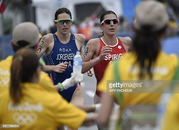 USA's Gwen Jorgensen and Switzerland's Nicola Spirig compete in the running portion of the women's triathlon at Fort Copacabana during the Rio 2016...