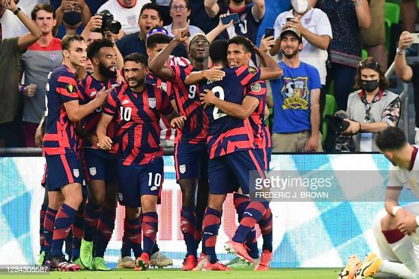 S Gyasi Zardes celebrates with teammates after scoring during the Concacaf Gold Cup semifinal football match between Qatar and USA at Q2 stadium in...