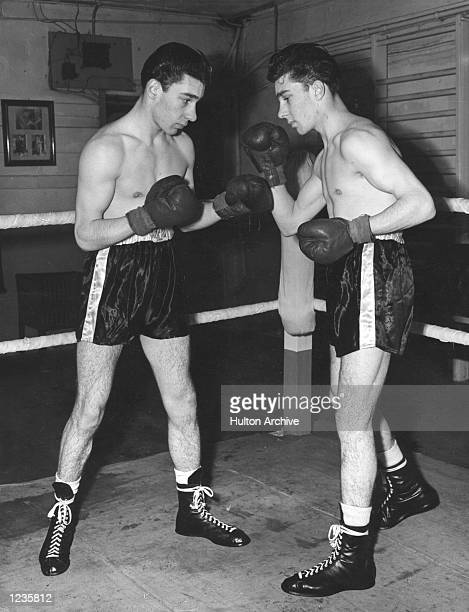 AND REG KRAY 18YEAROLD TWINS FROM BETHNAL GREEN IN THE EAST END OF LONDON IN TRAINING IN THE RING AT KLEIN's GYMNASIUM FOR THEIR NEXT BOXING CONTEST...