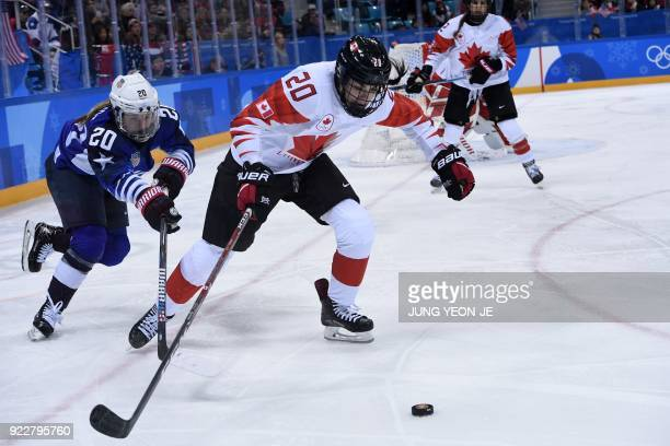 TOPSHOT USA's Hannah Brandt and Canada's Sarah Nurse fight for the puck in overtime in the women's gold medal ice hockey match between the US and...