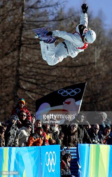 S Hannah Teter flys above the crowd enroute to winning the Gold Medal in the Ladie's Halfpipe Final of the 2006 Winter Olympics in Bardonecchia,...