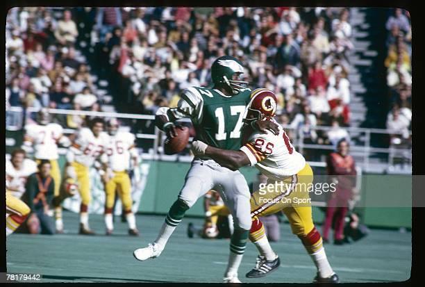 PHILADELPHIA PA CIRCA 1970's Harold Carmichael of the Philadelphia Eagles tries to break away from a Washington Redskins defender in a circa 1970's...