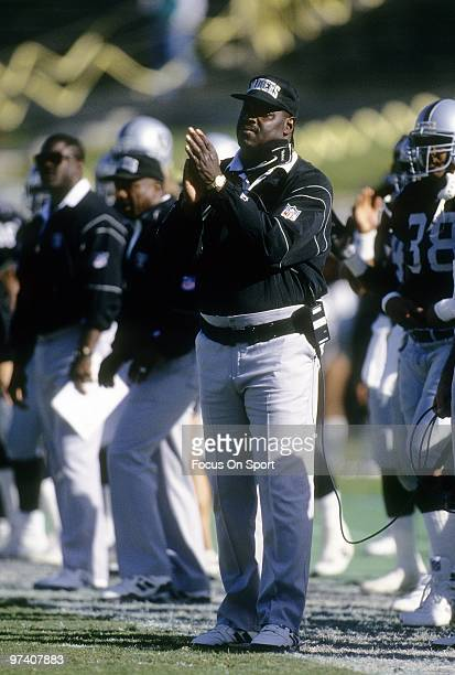 LOS ANGELES CA CIRCA 1990's Head Coach Art Shell of the Los Angeles Raiders watching the action from the sidelines applauds his player during an NFL...